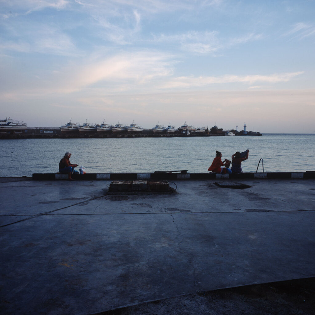 Locals relaxing in the harbour of Yalta