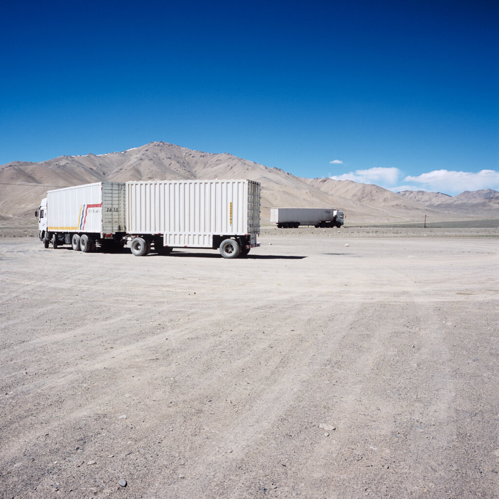 Chinese trucks taking the road after a lunch in Alichur